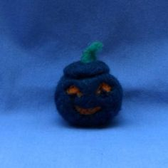 Night Blue Jack-o-Lantern with candlelight-orange eyes and playful friendly smile. Needle felted wool Halloween figure that can also be an ornament by MerryGardenCreatures for $15.00