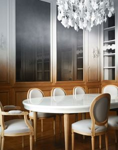 A custom white and blond wood dining room table in a mysterious apartment that seems all ombre.  Totally fascinated!