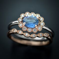 Oval engagement fashion ring with a .80ct blue ceylon Sapphire 10 round brilliant diamonds halo 14kt pink and white gold