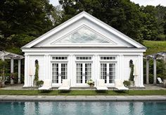 A lovely white pool house was built with enjoying the long views in mind. - Traditional Home ® / Photo: Werner Straube / Architect: James Crisp Transitional Living Rooms, Transitional House, Transitional Lighting, Pool Cabana, Building A Pool, New England Homes, Farmhouse Remodel, Beautiful Pools, Home Photo