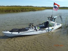 Kayak Fishing For Beginners when buying a kayak when buying a kayak does it have to have fishing rod holders built in or do you prefer to install some yourself? also what seems to be easier for landing fish a closed hull or open?