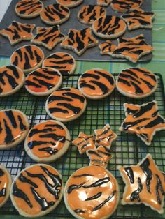 Made these cookies for my son's graduation class. Birthday Cupcakes, 21st Birthday, Tiger Cookies, Striped Cake, Paint Cookies, New Cake, Cute Cookies, Halloween Cookies, Down South