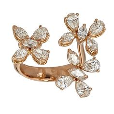 This exquisite 18kt rose gold ring features 2.79cts of sparkling marquise and pear shaped diamonds arranged as three beautiful flowers. This ring is also available in both yellow and white gold. Handcrafted in Italy by ZYDO Italian Jewelry.