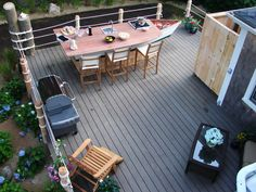 Awesome nautical inspired deck design, I am loving the rope railing!  I was thinking of doing something similar already and heres a great inspiration!