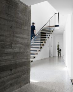 Stairs with a glass and steel railing connect the various levels of this modern house, Floating Staircase, Modern Staircase, Wood Stairs, House Stairs, Steel Railing, Storey Homes, Ground Floor Plan, Modern Coastal, Australian Homes