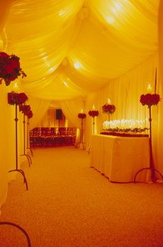 A beautifully draped ceiling and cream silk walls transform a wedding tent into a dreamy winter fairytale.