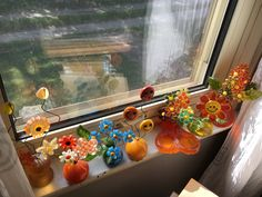 Another part of my indoor garden, lucite flowers on my window sill