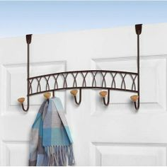 Spectrum Diversified 89024CAT Twist Over Rack Hook by Spectrum. $26.98. Finish/Color Options:Bronze Organize in style! Optimize your space in style with this handy five-hook over the door hook rack. It fits neatly over the door and will give you plenty of space to hang coats, jackets, sweatshirts, purses and more.  Available in black or bronze