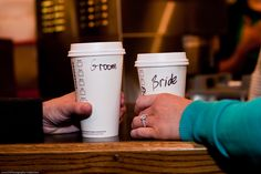 Bride and Groom Starbucks Coffee Cups (taken at the original Starbucks).  Pike Place Market Engagement Photo by Seattle and Los Angeles Wedding Photographer, Trina with PS Photography.  LIKE us at http://www.facebook.com/WeddingPhotographyandVideo and check out our site at http://psphotography-video.com