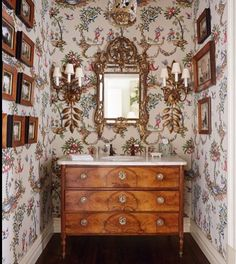 Love the chinoiserie toile wallpaper and the square wood frames