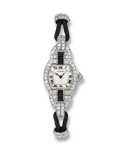 A LADY'S ART DECO DIAMOND AND ENAMEL WRISTWATCH, BY CARTIER   The tonneau-shaped cream dial with blued steel hands and black Roman numerals within a pavé-set diamond surround with onyx detail to the silk cord strap with black enamel deployant clasp, the reverse engraved 'M.C.F. M.C.P 24th Jan 1935', early 1930s, case 1.7 cm wide, with French assay marks for platinum and gold  Dial signed Cartier, case Nos. 20516, 6597 and 16708; movement signed EWC, No. 20516, case No. 16708