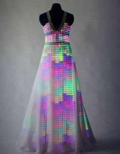 SWAROVSKI CRYSTAL EVENING GOWN COMES ALIVE WITH TINY LED LIGHTS.
