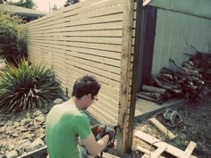 DIY Modern Fence?  worth looking into.