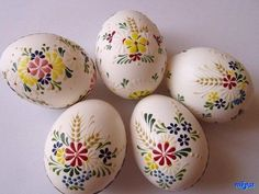 Blown eggs painted with melted wax.