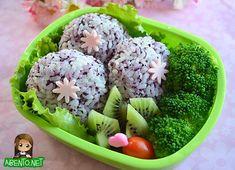 An almost vegetarian bento with purple shiso onigiri and fresh fruits and veggies.