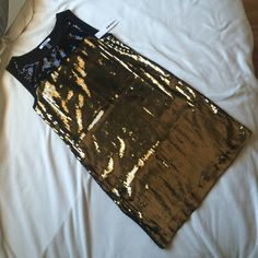 DKNY Bronze and black sequined dress - NWT!! NWT bronze and black sequined tank dress from DKNYc. Perfect condition! No missing sequins or loose strings. If you have any questions or would like more photos, please don't hesitate to ask! Thanks for taking a look! DKNY Dresses