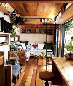 Warm wood floors and ceiling in this tiny house