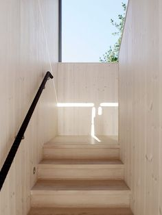 Larch clads both the interior and exterior of thisgabled holiday home byJohan Sundberg, whichstands in a forest next to a white sandy beach in Österlen.