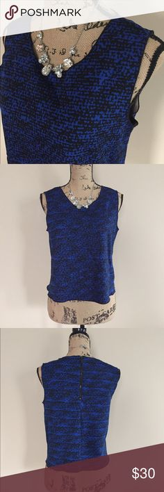 NWOT Vince Camuto sleeveless top NWOT Sapphire blue and black pattern top by Vince Camuto. Sleeveless, zip back, scoop neck. Size S. 93% polyester 7% spandex. Machine wash. Vince Camuto Tops Blouses