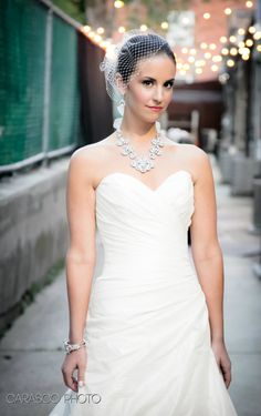 We love the Ti Adoro Multi Teardrop Necklace with the silk organza ribbon (choice of white or ivory; available at Bella Bleu Couture Bridal & Specialty Accessories;