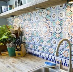 reclaimed wood shelving   woodtop counter   moroccan tile backsplash