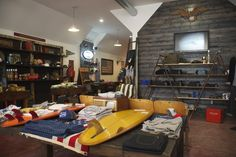 Love this store layout! Brick on wall shaped to look like vaulted ceiling A Frame Bookshelf, Bookshelves, Garage Studio, Store Layout, Management Styles, Surf Shop, Retail Design, My Room, Barn Wood