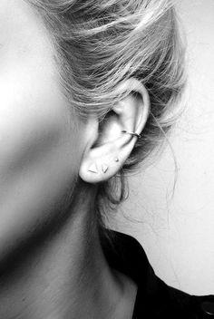 Multiple earrings.