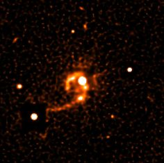 photograph of Quasar HE 1013-2136 (center) and its surroundings sharpened with a computer algorithm to bring out more details in the immediate neighbourhood of the quasar. Now numerous details can be recognized within the two tidal tails, including various knotty structures. In particular, a very close companion galaxy at 20,000 light-years projected distance to the quasar can now be seen (at the 5 o''clock position) that may be in gravitational interaction with the quasar host galaxy.