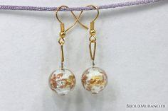 Boucles d'oreilles Palla Blanche : Ces boucles d'oreilles en verre de Murano sont composées d'une perle de cristal et d'une magnifique perle de Murano qui  ..