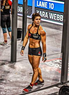 CrossFit competition Stacie Tovar black thin strap sports bra pro shorts red shoes Reebok Nanos 3.0