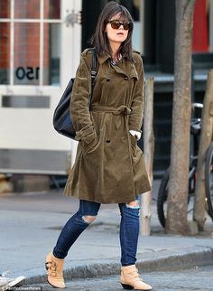 Not up to her usual fashion standards: Katie Holmes, 35, steps out in a corduroy jacket in New York on Thursday