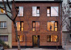 MAPA updates Chilean housing block with textured brick facade
