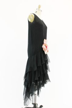 Simply breathtaking! 1920s vintage black silk chiffon gown. This gorgeous beauty is styled in a modern high-low cut. Extreme drop waist that flares