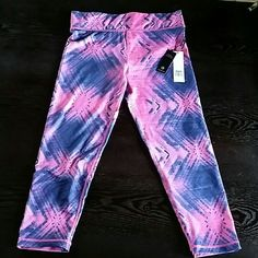 Medium multi colored leggings WIcking technology . Moisture control. Wicks moisture away from skin. Stay soft and breathable. Keeps your skin dry ,bringing your prediction,comfort and care. Keeps performing after washing. Velocity  Pants Track Pants & Joggers
