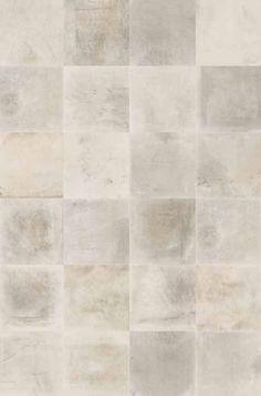 Grote beton look vloertegels in verschillende tinten ideaal voor in de woonkamer!