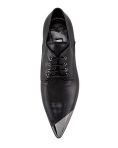 HIM FOR HER: Nothing like a Miu Miu slanted cap-toe brogue to add a little chutzpah to your look.