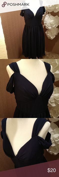 Navy Blue Dress This dress is gorgeous and the way the straps fall so nicely on the arms looks so princess like.  The flow of the fabric is so girly and it's just one of my favorite dresses THIS DRESS IS A LARGE WILL FIT A SIZE 10 Mystic Dresses Midi