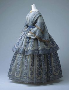 c. 1859-1860. Wide, three-quarter length pagoda sleeves which were usually highly decorated with fringing, bows or ruching and included full-length under-sleeves with patterned lace cuffs.
