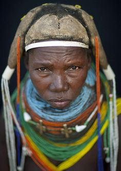 Mwila Woman Wearing The  'Vilanda'  Necklace, Chibia Area, Angola . by Eric Lafforgue