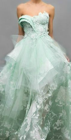 This gown was the pale green of sea foam, and the gauzy skirt contrasted with the structured, coral-like bodice.