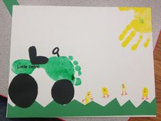Foot print tractor with finger print chicks and a hand print sun! The toddlers loved that we painted both their hand and foot!