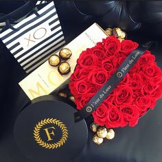Valentine's Day essential. Rouge red roses, Moët champagne and Ferraro Roche  Fleur du Luxe preserved roses from Ecuador in our signature hat box xxx boxed flowers