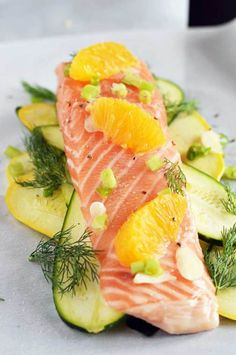 Summer Citrus Salmon En Papillote (in Paper).  This recipe only takes a few minutes to put together and features fresh seasonal flavors that will knock your socks off.  The fish essentially steams itself in a parchment paper packet, and no oil or butter is needed for a healthy, delicious meal! | hostthetoast.com
