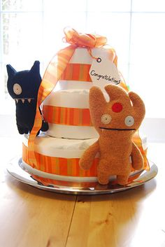 A cake graced by Uglydolls, and whose most important feature is the secret inside. | 19 Stunning Diaper Cakes Anyone Can Make