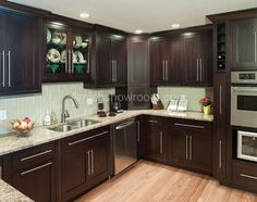 Love the cabinet colors and recessed lighting. Also love the thin spice cabinet and wine rack next to the oven.