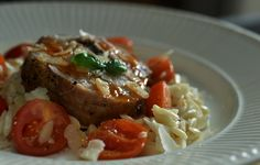 Roasted lamb with risoni and cherry tomatoes