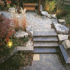 A mix of natural stone, interlocking pavers and plants bring this backyard escape to life.