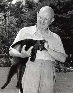 P G Wodehouse    The UK author at his Remsenberg, New York, home in 1958 with Blackie, one of two cats and four dogs he owned