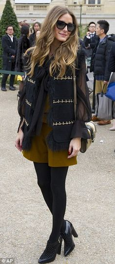 Olivia Palermo looked fabulous as she layered up her outfit for the Parisian weather