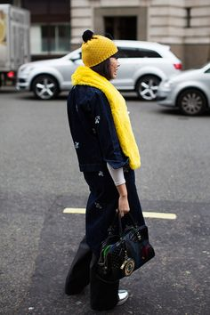 I love the yellow scarf. Yellow and black.